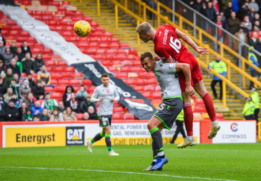 Aberdeen's Sam Cosgrove scores a header to make it 1-1 during the Ladbrokes Premiership match between Aberdeen and Hibernian at Pittodrie.
