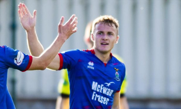 Mitch Curry celebrates netting for Caley Thistle against Alloa.