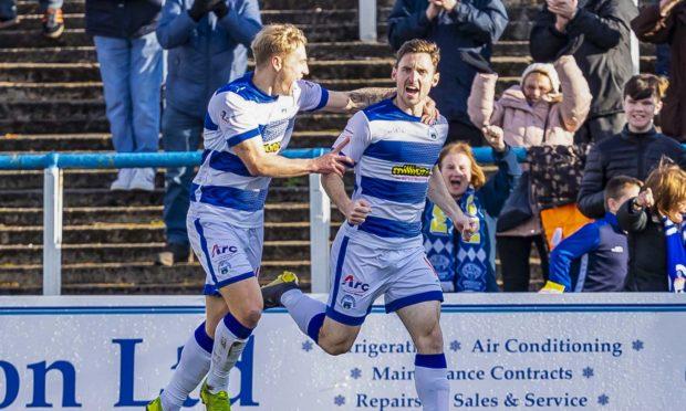Bob McHugh celebrates scoring for Morton.