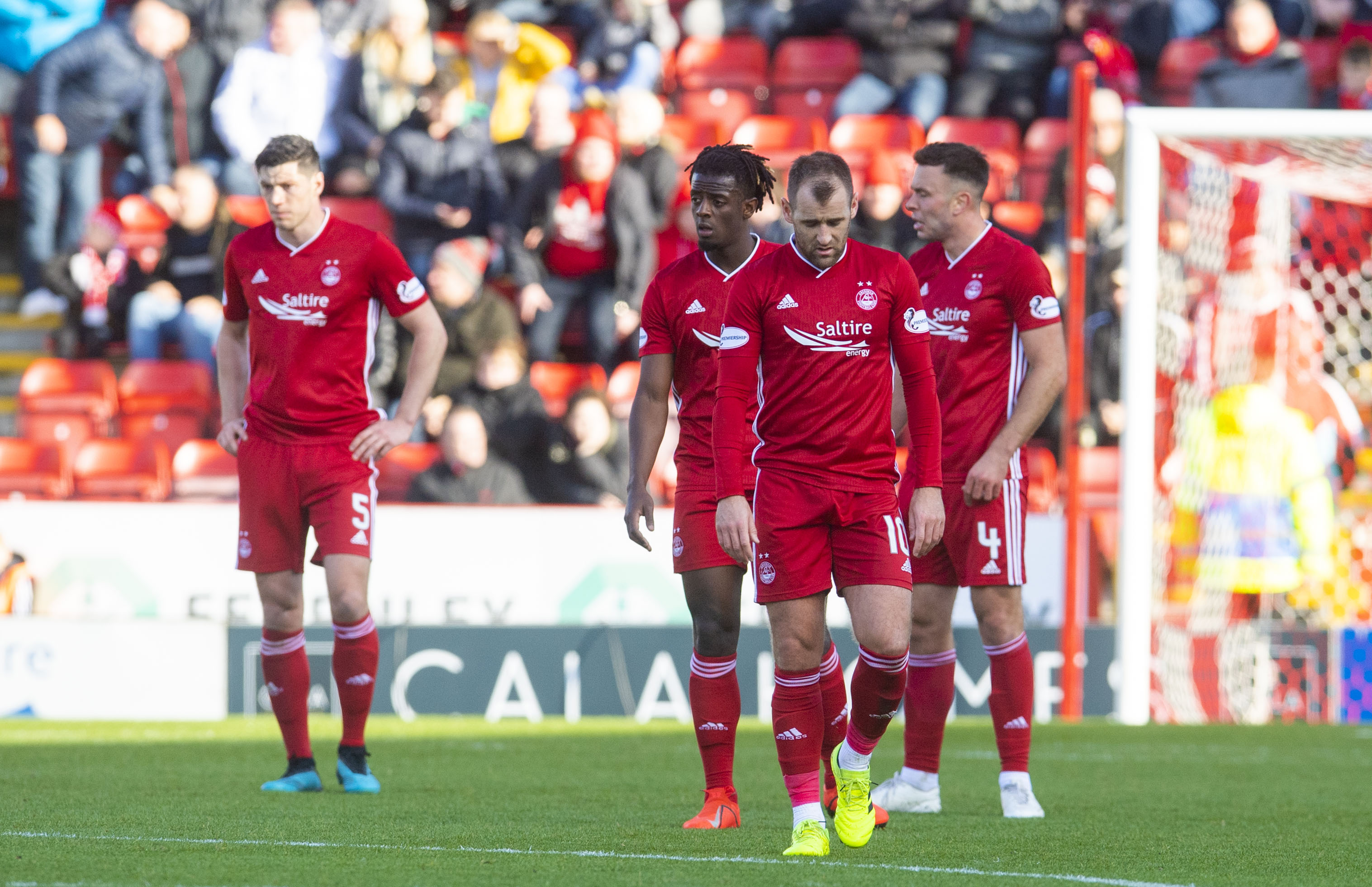 Aberdeen's players stand dejected after conceding the fourth goal