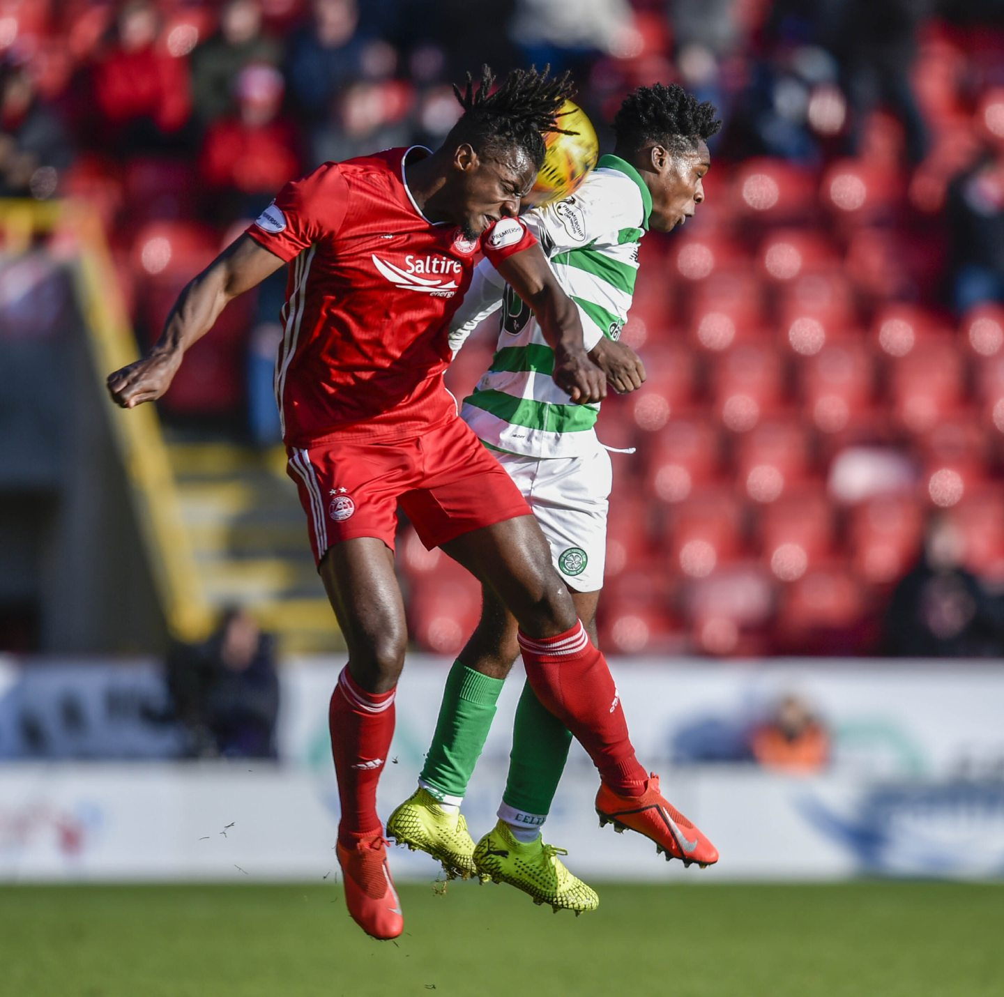 Aberdeen's Greg Leigh (L) in action with Celtic's Jeremie Frimpong last season