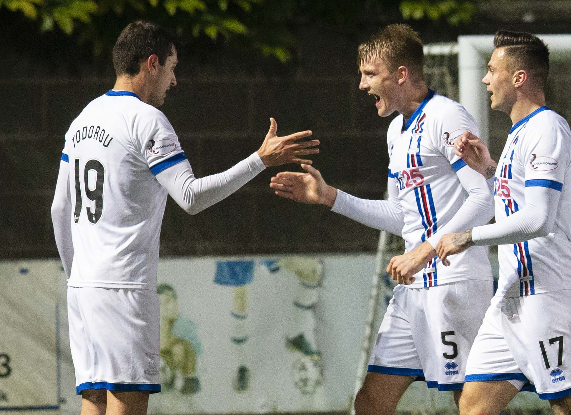 Nikolay Todorov (left) celebrates his goal with team-mate Coll Donaldson during the Ladbrokes Championship match between Queen of the South and Inverness.