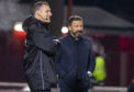Aberdeen manager Derek McInnes, right, exchanges a joke with fourth official Euan Anderson.