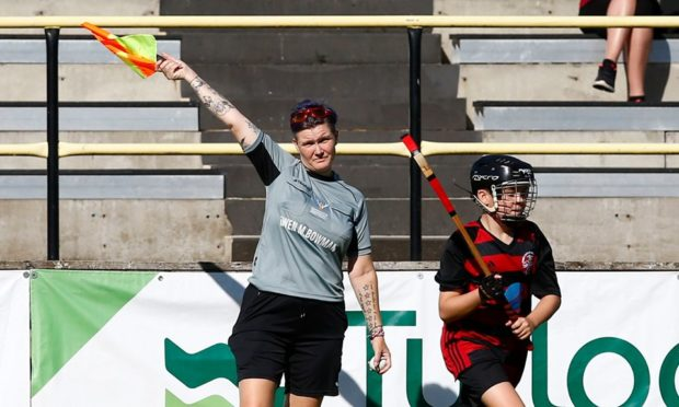 Tina Marshall from Kiltarlity pictured refereeing a match