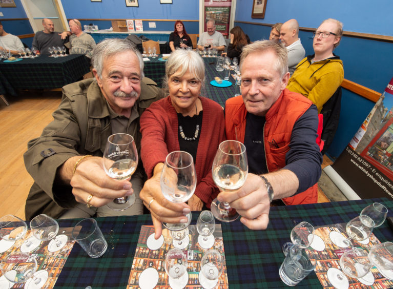 Whisky tasting in a hall near The Whisky Shop in Dufftown, which is part of the inaugural Whisky Colours Festival run by the owner of the shop to encourage visitors to area outside summer months. Pictured: Whisky tasting customers from the USA Stuart and Judy Miller and Urban Fasth, from Sweden.