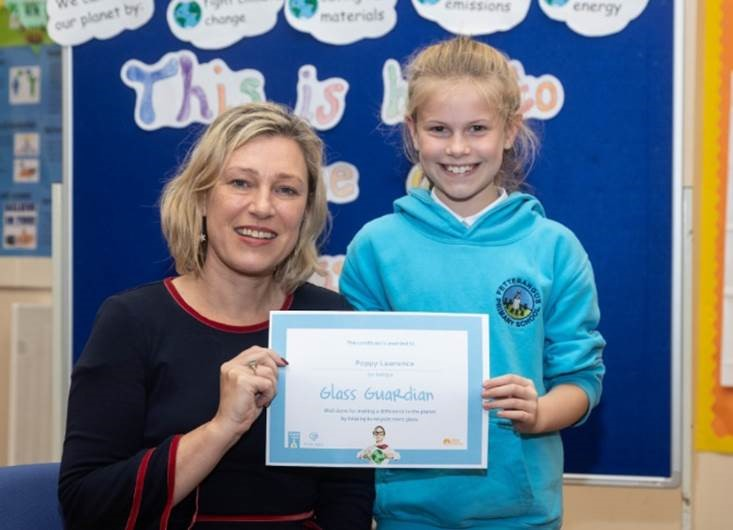 MSP Gillian Martin with one of the Fetterangus pupils awarded for their glass recycling song