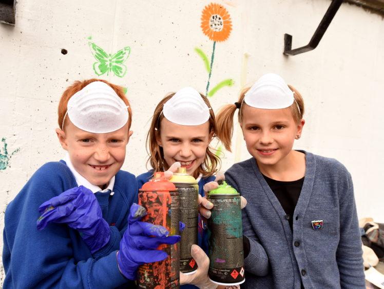 Gilcomstoun School pupils (L-R), Charlie Beattie, Isla MacPhee and Eilidh Gronkonski.