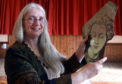 Artist Linda Cannon with one of the pieces.  Picture by Jim Irvine