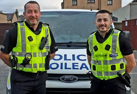Recently retired Moray Sergeant Ally Bruce and his son PC Harry Bruce