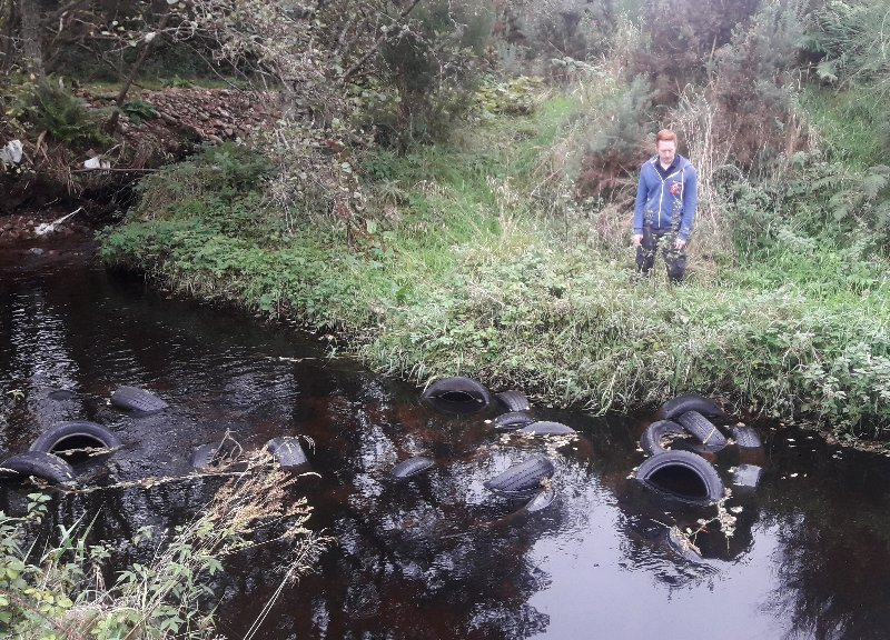 Hundreds of tyres have been found illegally flytipped into the Black Burn near Pluscarden Abbey last week.