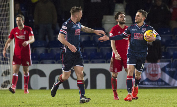 Ross County's Alex Schalk, right, celebrates pulling a goal back in January 2018.
