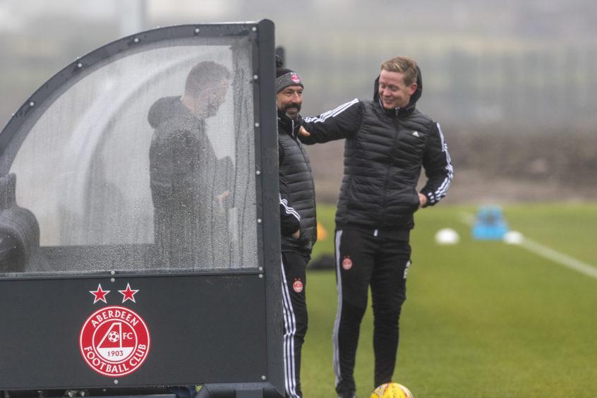 Boss McInnes jokes with coach Barry Robson.