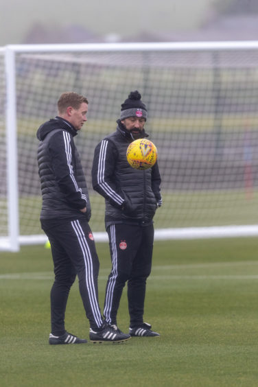 Derek McInnes keeps the ball up with coach Barry Robson.