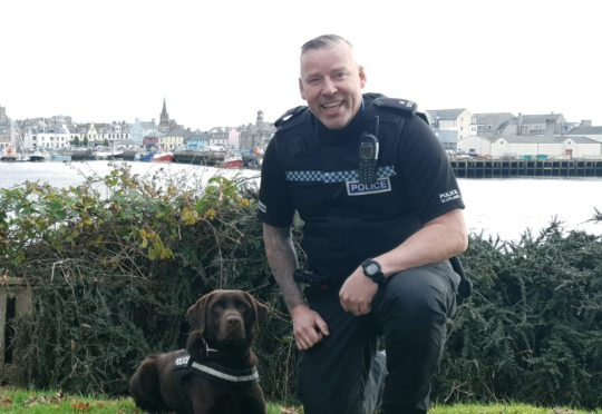 Drugs detection dog 'Bear' and the newly qualified handler, Constable Stuart Wightman