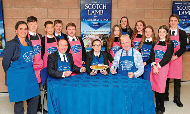 Balfron High School Home Economics pupils get ready to cook for #LambforStAndrewsDay with QMS Chair Kate Rowell (left), George Purves, Managing Director of United Auctions seated with pupil Beth Rodgers and Chief Executive of QMS Alan Clarke.