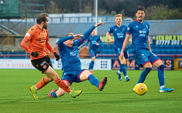 Dundee Utd's Paul McMullan's shot is deflected into the goal off Inverness' Shaun Rooney to make it 1-0 during the Ladbrokes Championship match between Inverness CT and Dundee United