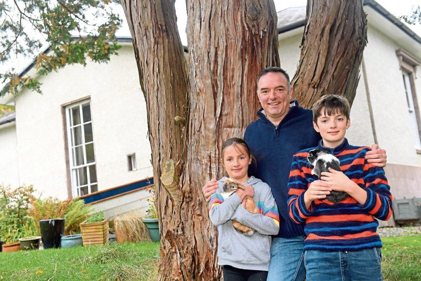 Magnus Wardle, his two children Georgina and Barnaby with their pet rabbits Bailey and Sid.  Picture by KATH FLANNERY