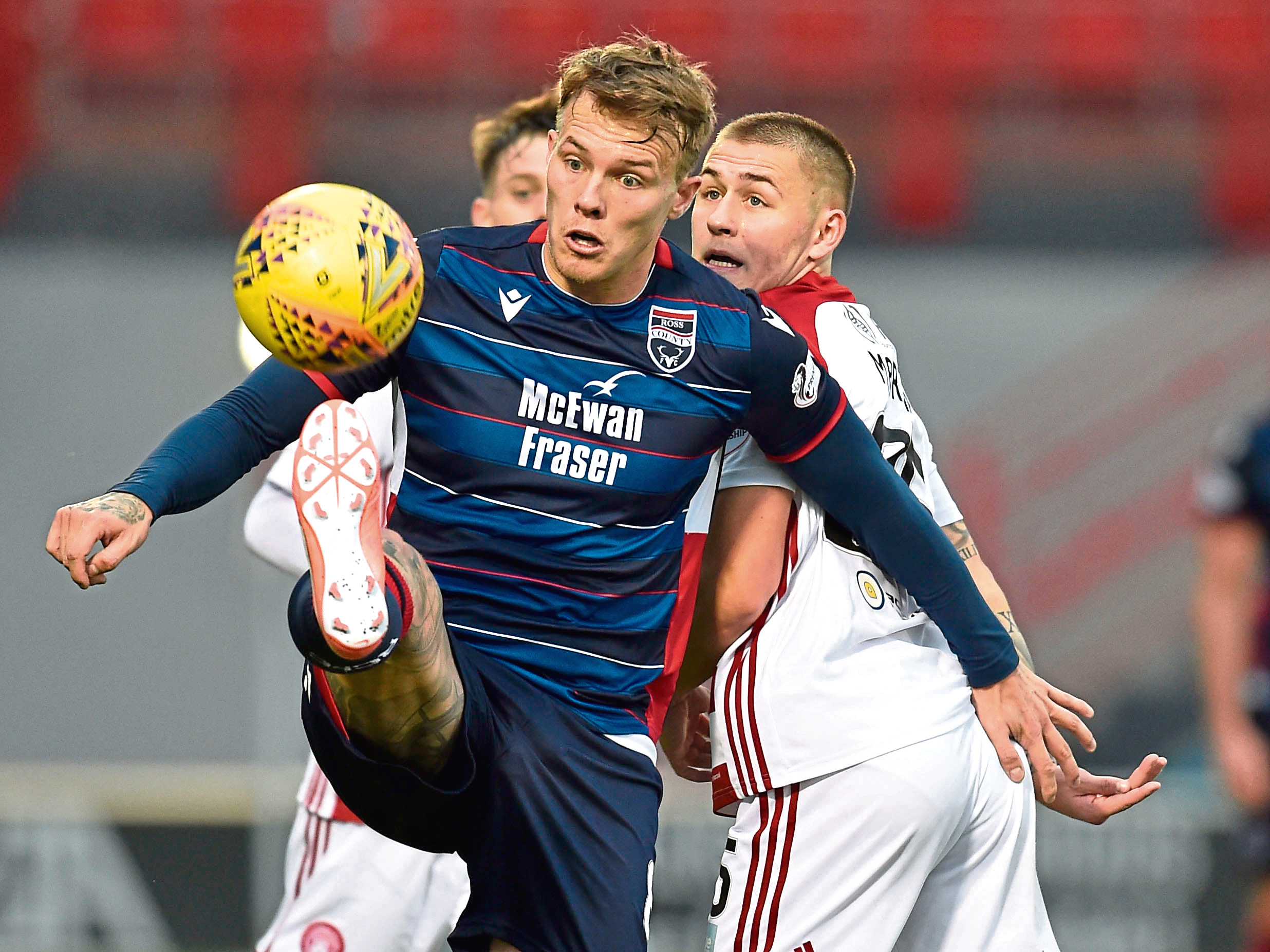 Ross County's Lee Erwin, left, competes with Scott Martin during the Ladbrokes Premiership match between Hamilton and Ross County.
