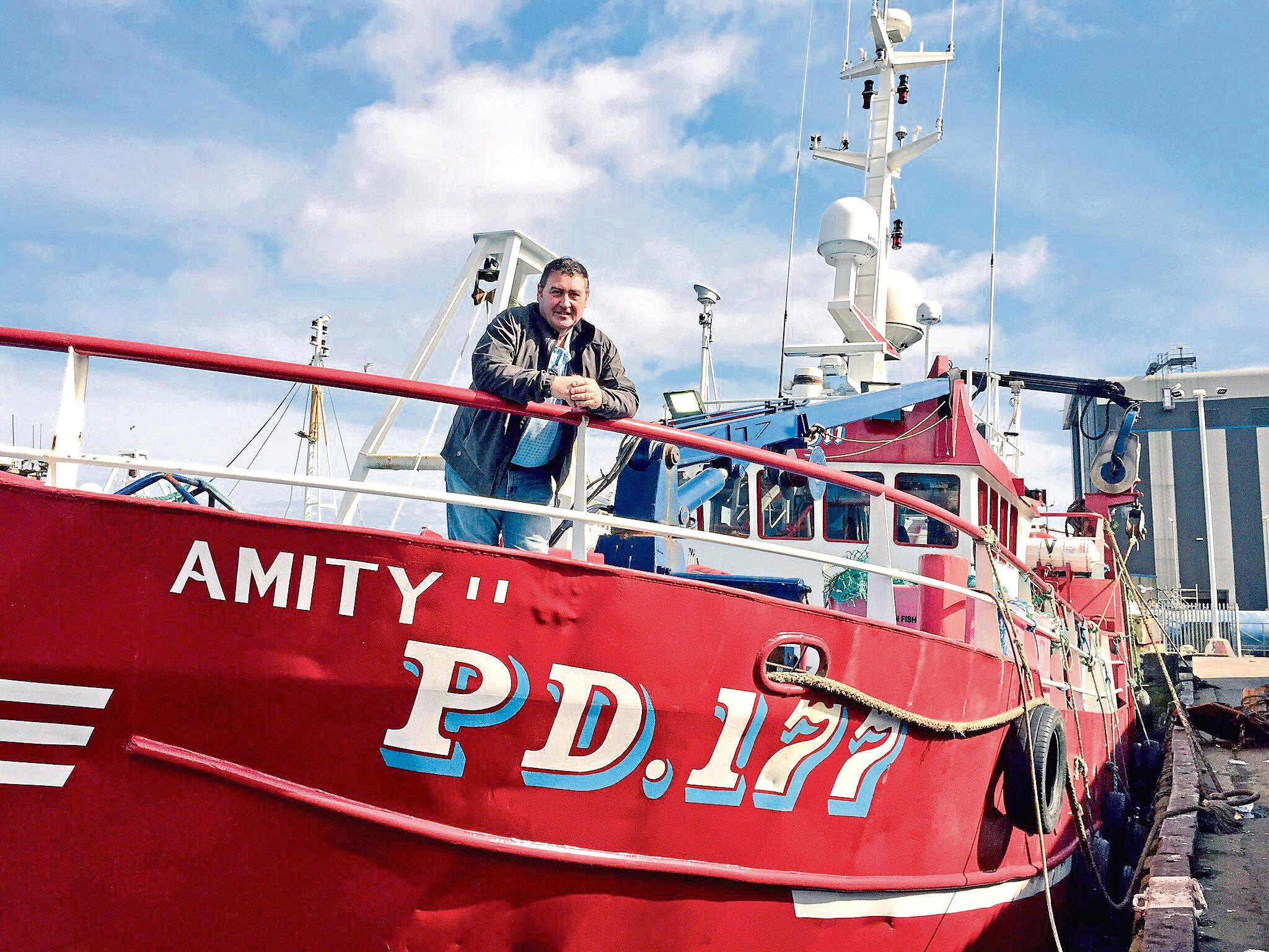 Jimmy Buchan on his boat, Amity II