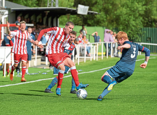 Formartine's Jonathan Crawford and Turriff's Owen Cairns. Picture by Kath Flannery