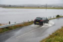 Flooded road and fields near Kintore Golf Club Paul Glendell 011119 -01-05