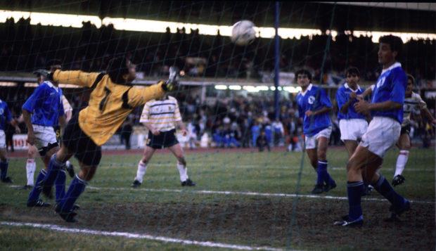 Scotland's Richard Gough (hidden, back right) heads home his side's 89th minute winner.