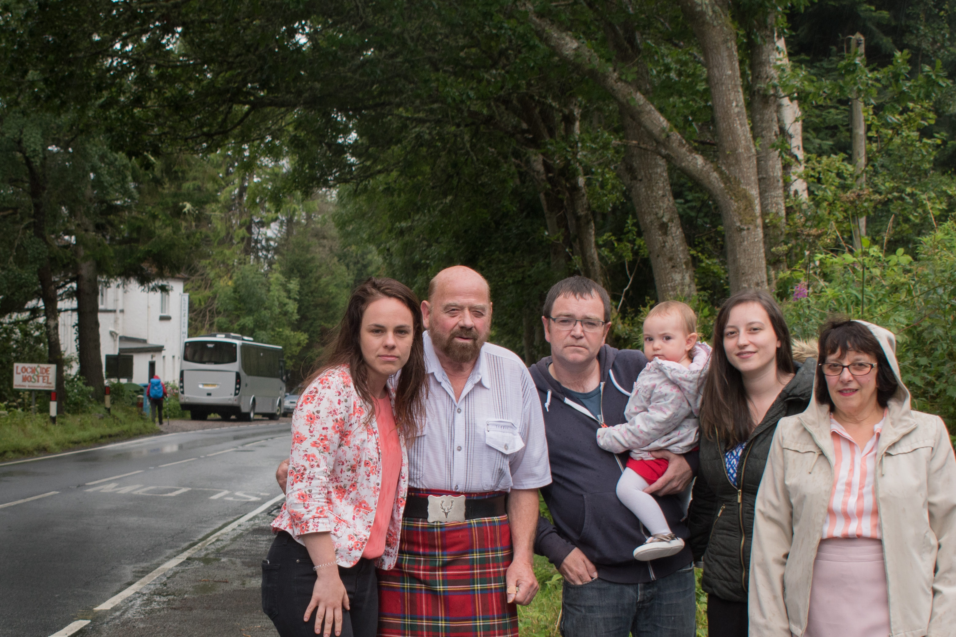 Alltsigh residents Duncan McIntosh, Andrew Park, Maya Park, Yvonne McIntosh and May McIntosh with Kate Forbes MSP where the planned pavement will be installed