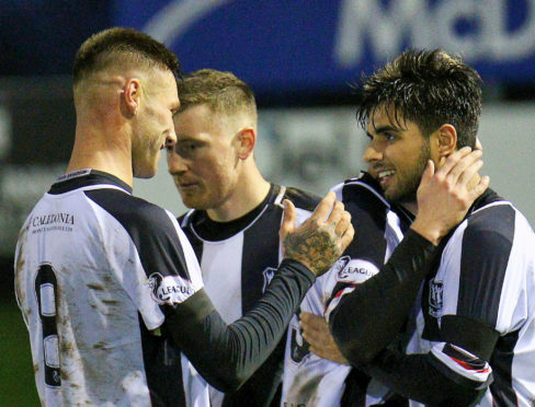Rabin Omar celebrates with team-mates after scoring his second and Elgin's fourth and final goal.