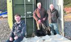 Kenny Brandie, Fishermen's Mission superintendent (front) with Fishermen Bill Westland (with Maisie, dog) and Jim Adam. Picture by Colin Rennie.