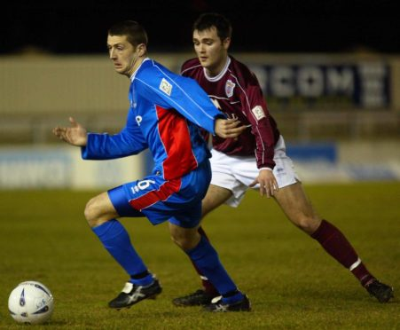 ICT's Roy McBain gets away from Arbroath's Ed Forrest during a league match in the 2002-3 season.