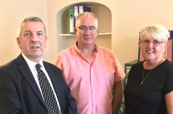 Highlands and Islands MSP David Stewart, pictured left, with Graham and Diane Matheson.