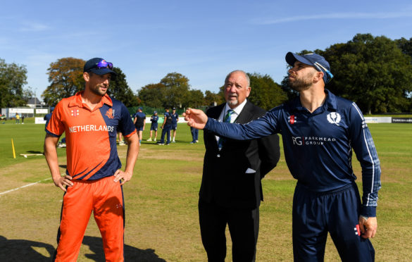 Kyle Coetzer of Scotland tosses the coin with Pieter Seelaar of Netherlands prior to the T20 International Tri Series match between Scotland and the Netherlands.