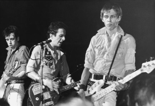 From left to right, Mick Jones, Joe Strummer and Paul Simonon of punk rock band The Clash, circa 1980.