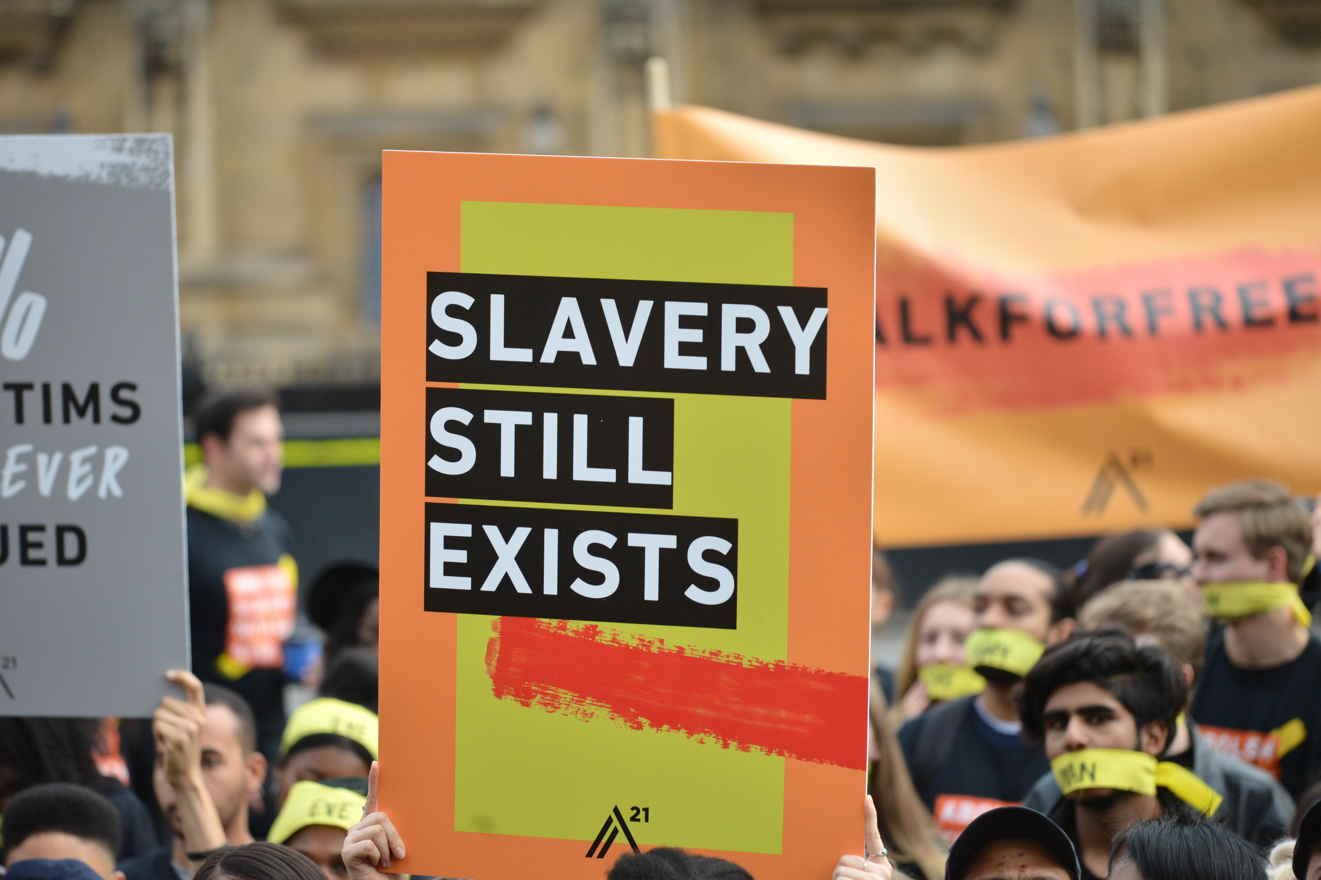 LONDON, UNITED KINGDOM - OCTOBER 14: People marching against modern slavery through London wearing face masks representing the silence of modern slaves in forced labour and sexual exploitation on October 14, 2017 in London, England.  PHOTOGRAPH BY Mathew Chattle / Barcroft Images (Photo credit should read Mathew Chattle / Barcroft Media via Getty Images / Barcroft Media via Getty Images)