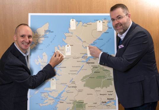 Chris Taylor, VisitScotland Regional Leadership Director and Jóhannes Þór Skúlason, of the Icelandic Travel Industry Association, who was the keynote speaker at the Highland Tourism Conference, are pictured with a map of the Highlands onto which delegates were encouraged to share and pin their hidden gems, with the idea of distributing visitors to new locations right cross the Highlands which they might not have thought of visiting.