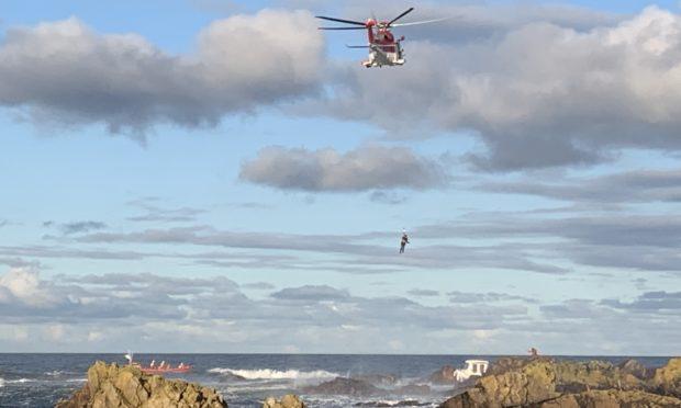 Coastguard helicopter on the scene.