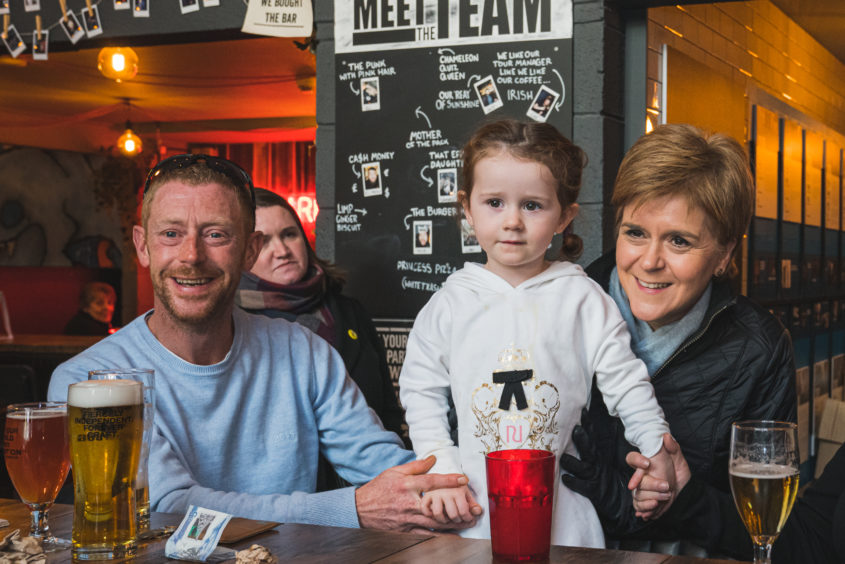Nicola Sturgeon in BrewDog Dog Tap, Ellon, with patrons. Picture by Jamie Ross.