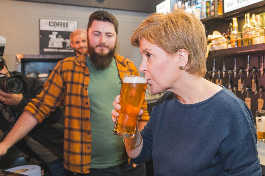 Nicola Sturgeon in BrewDog Dog Tap, Ellon, sampling a beer. Picture by Jamie Ross