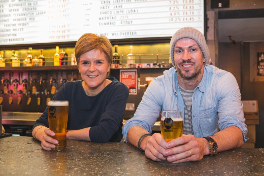 Nicola Sturgeon in BrewDog Dog Tap, Ellon, samples a beer with co-owner James Watt. Picture by Jamie Ross.