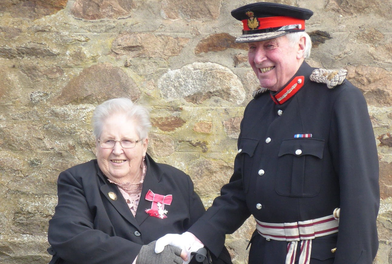 Mrs Morris receives her MBE from James Ingleby, Lord Lieutenant of Aberdeenshire.