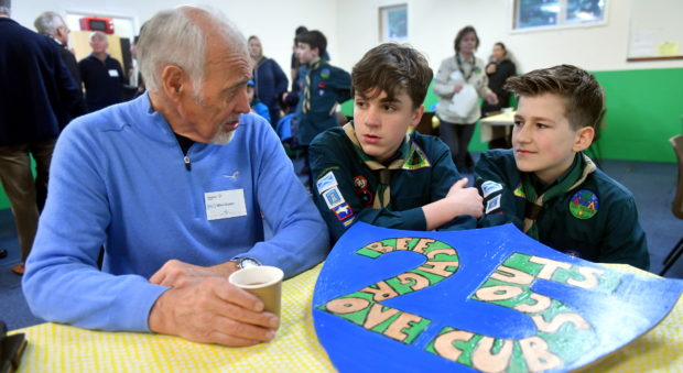Mike Walker, who was in the 25th Aberdeen Scouts in 1954, talks to youngsters Nathan Senff and Luke Miller. Picture by Chris Sumner