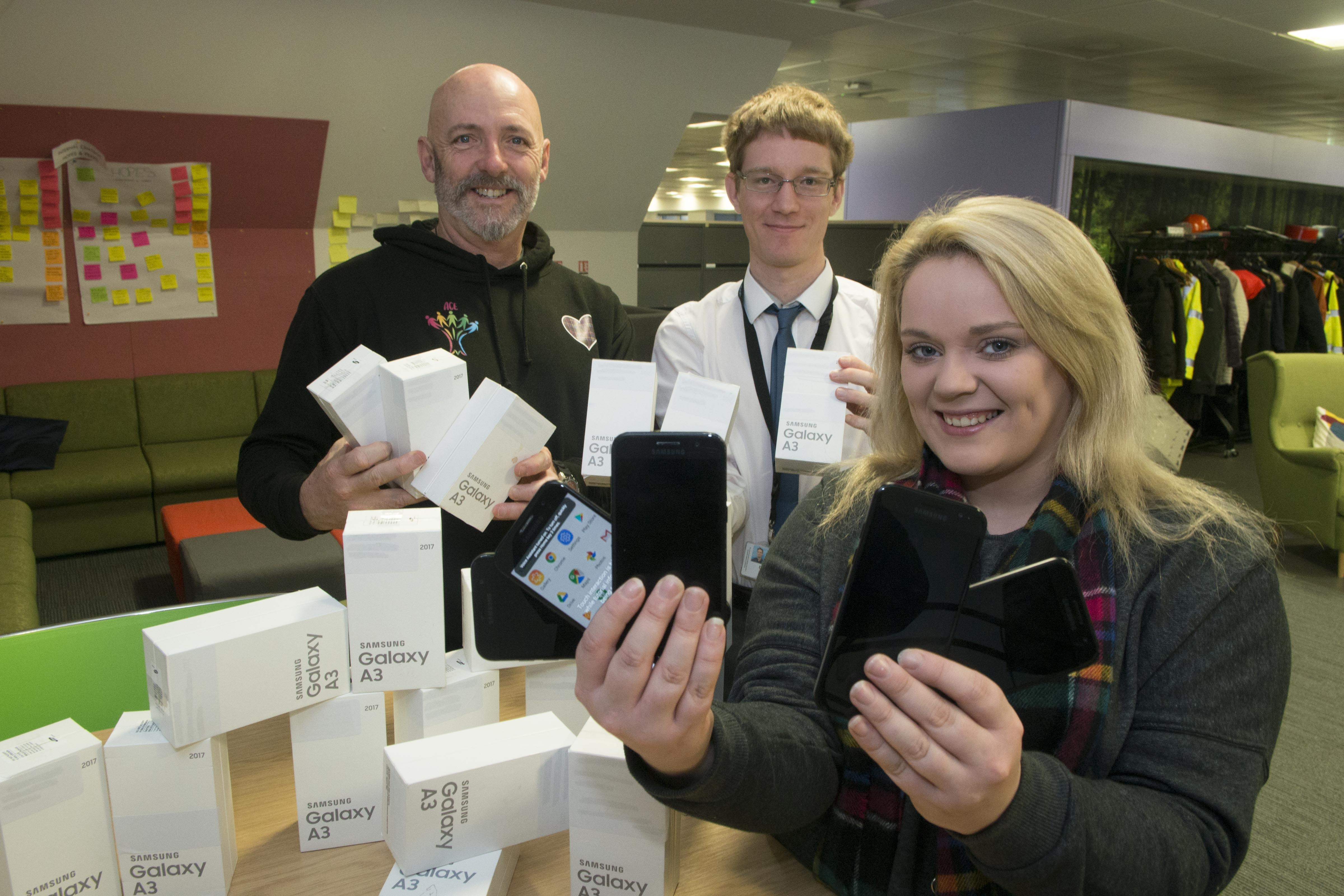 26/11/19 L-R Peter Melrose (Development Officer -Who Cares Scotland), David Barlett (Aberdeen City Council I.T Analyst0 Tiffany Burnett (Aberdeen City Council Children Rights Development Officer)  Care experienced young people are to be provided with surplus staff mobile phones from Aberdeen City Council following a request made by the city's Champions Board which brings together care experienced young people with multiple public partners who have corporate parenting responsibilities. The phones became surplus to requirements following a recent upgrade and the council's Integrated Children and Family Services team have been working with their IT colleagues to clear data and make the devices usable again.