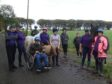 A group of the people supported by Buchan Community Farm out on a walk with some of the horses