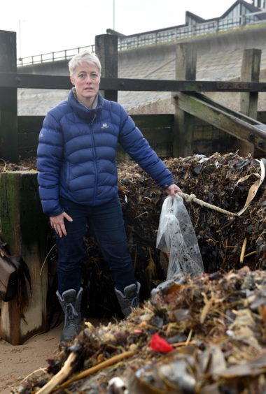 A pile of plastic has washed up on the beach and a concerned resident is worried it will be washed back into the sea when the tide comes in. Pictured is Gail Dicksman with some of the rubbish washed up on Aberdeen Beach. Pictured on 19/11/2019 CR0016578