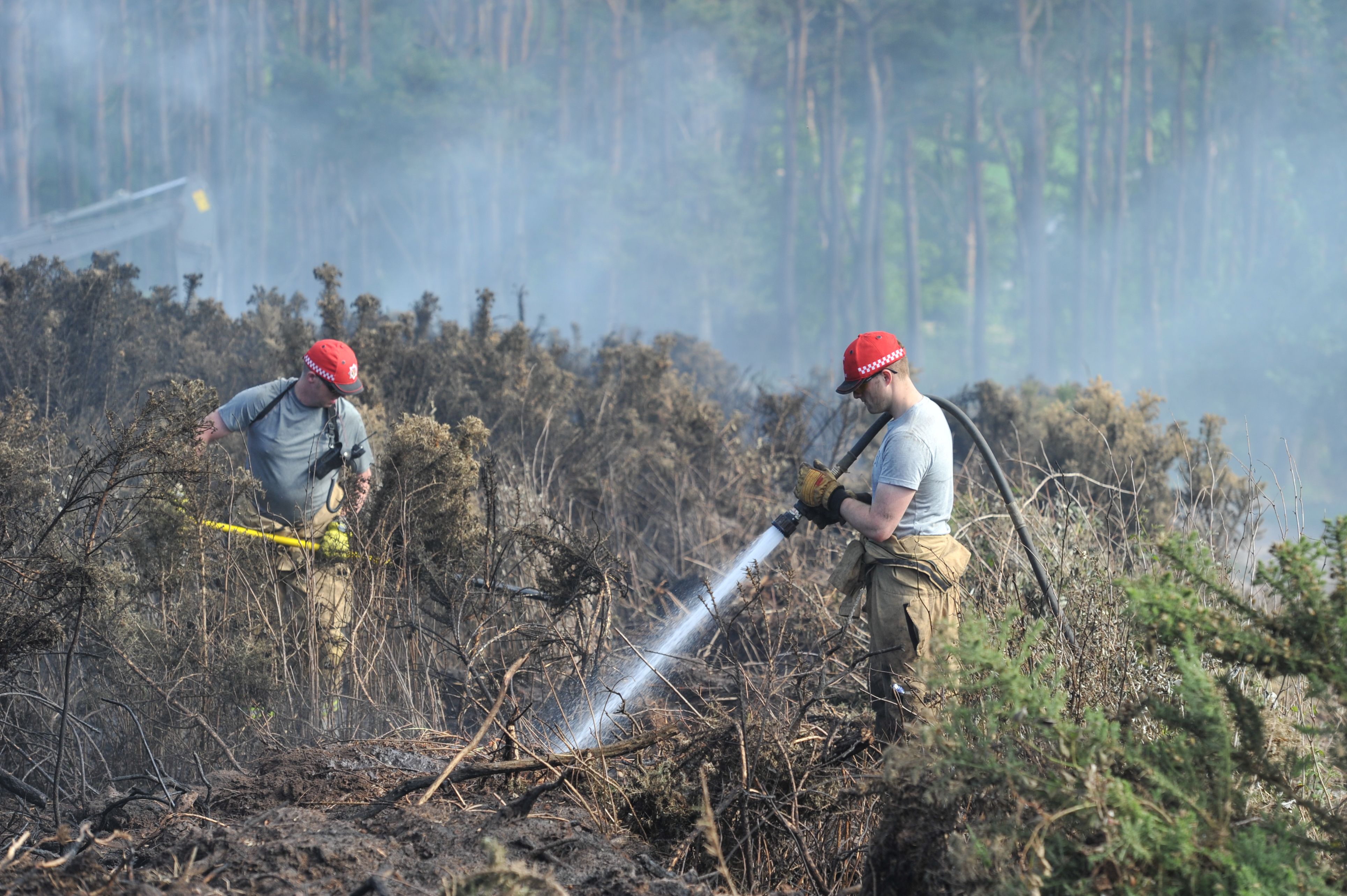 Firefighters tackle a gorse blaze near Hopeman in July 2018. Picture by Jason Hedges.