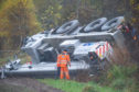 A crane goes off the road on the A96 Elgin to Forres at Alves, Moray.