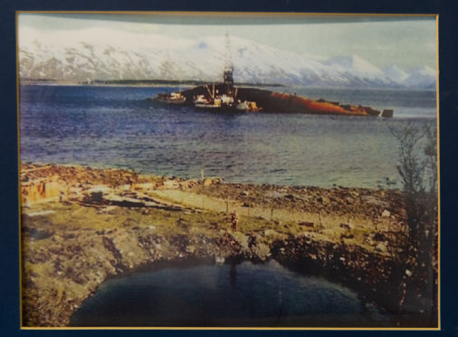 The stricken Tirpitz, which capsized and sank during the successful November 12 raid in 1944