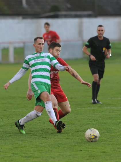 Brora 6 Gavin Morrison v  Captain Buckie Kevin Fraser Picture by JASON HEDGES