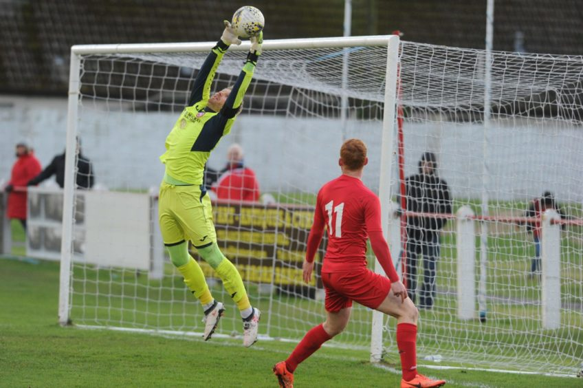 Buckie Goalie makes a good save. Picture by JASON HEDGES