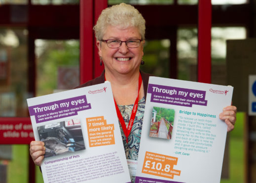 Jane Hill, family wellbeing worker with Quarriers, is pictured at the photo exhibition currently on display.